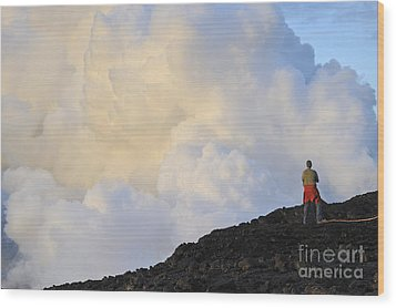 Man Contemplating Clouds Of Steam On Volcano Wood Print by Sami Sarkis