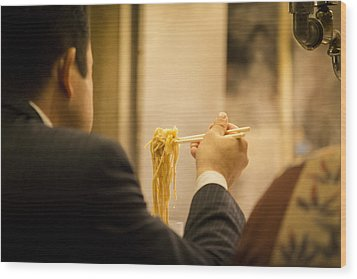 Man Eating Noodles In A Restaurant Wood Print by Ruben Vicente