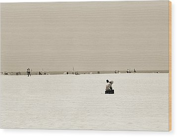 Man Sitting On A Beach Playing His Horn Wood Print by Stephen Spiller