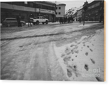 melting ice and snow on street surface holmen Honningsvag finnmark norway europe Wood Print by Joe Fox