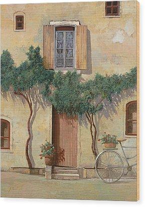 Mezza Bicicletta Sul Muro Wood Print by Guido Borelli
