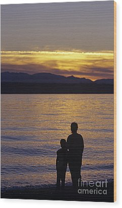 Mother And Daughter Holding Each Other Along Edmonds Beach At Su Wood Print by Jim Corwin