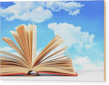 Open Book Against A Blue Sky Wood Print by Sandra Cunningham
