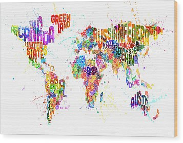 Paint Splashes Text Map Of The World Wood Print by Michael Tompsett