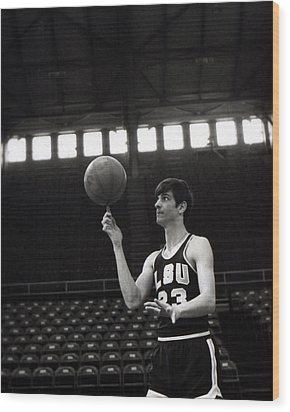 Pete Maravich Spinning Ball On Finger Wood Print by Retro Images Archive