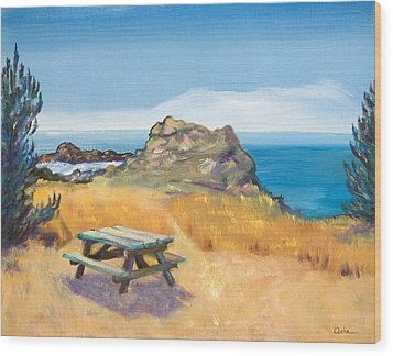 Picnic Table And Ocean With Yellow Field Wood Print by Asha Carolyn Young