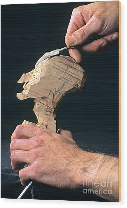 Puppet Being Carved From Wood Wood Print by Bernard Jaubert