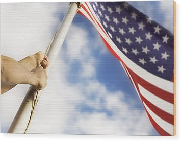 Raising An American Flag Wood Print by Chris and Kate Knorr