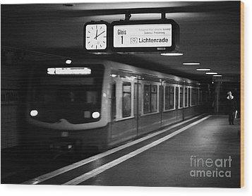 s-bahn train speeding through unter den linden underground station Berlin Germany Wood Print by Joe Fox