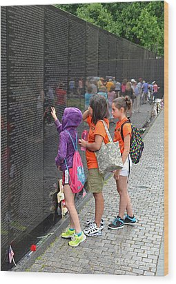Searching A Loved Ones Name On The Vietnam Veterans Memorial Wood Print by Jim Fitzpatrick