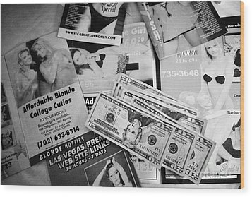 Selection Of Leaflets Advertising Girls Laid Out On A Hotel Bed With Us Dollars Cash In An Envelope  Wood Print by Joe Fox