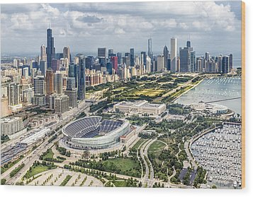 Soldier Field And Chicago Skyline Wood Print by Adam Romanowicz