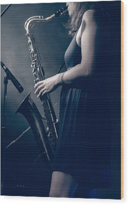 The Saxophonist Sounds In The Night Wood Print by Bob Orsillo