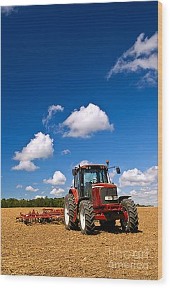 Tractor In Plowed Field Wood Print by Elena Elisseeva