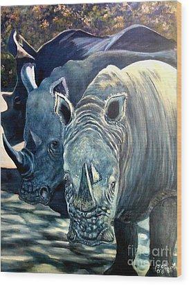 Trio Of Rhino Wood Print by Caroline Street