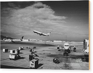 united airlines aircraft taking off taxiing and on stand at the San Francisco International Airport  Wood Print by Joe Fox