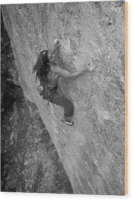 A Caucasian Women Rock Climbing Wood Print by Bobby Model