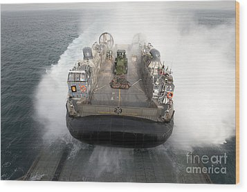 A Landing Craft Air Cushion Enters Wood Print by Stocktrek Images