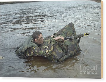 A Soldier Participates In A River Wood Print by Andrew Chittock