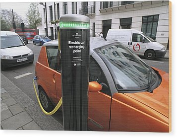 Recharging An Electric Car Wood Print by Martin Bond