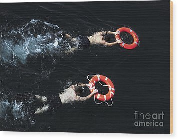 Search And Rescue Swimmers Wood Print by Stocktrek Images