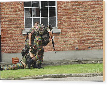 Soldiers Of The Belgian Army Helping Wood Print by Luc De Jaeger