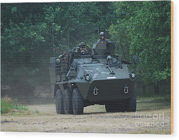 The Pandur Recce Vehicle In Use Wood Print by Luc De Jaeger