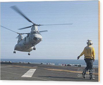 A Ch-46e Sea Knight Helicopter Prepares Wood Print by Stocktrek Images