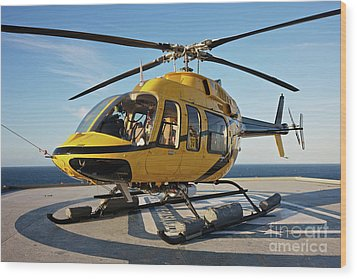 A Bell 407 Utility Helicopter Wood Print by Terry Moore