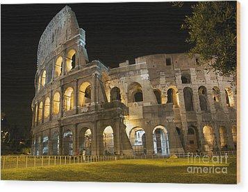 Coliseum Illuminated At Night. Rome Wood Print by Bernard Jaubert