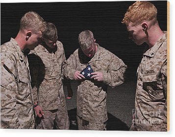 U.s. Marines Fold The American Flag Wood Print by Terry Moore