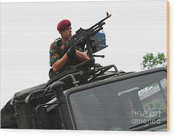 A Belgian Paratrooper Manning A Fn Mag Wood Print by Luc De Jaeger