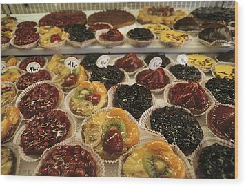 A Display Case Full Of Fruit Pastries Wood Print by Gordon Wiltsie