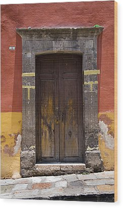 A Door In A Painted Building Wood Print by David Evans