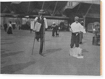 A Handicapped Man Selling Newspapers Wood Print by Everett
