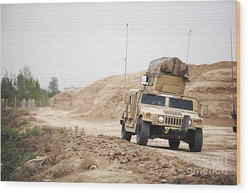 A Humvee Conducts Security Wood Print by Stocktrek Images