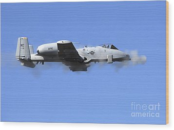 A Pilot In An A-10 Thunderbolt II Fires Wood Print by Stocktrek Images