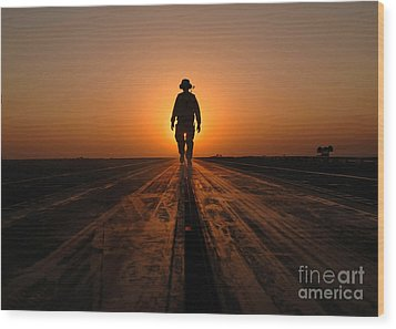 A Sailor Walks The Catapults Wood Print by Stocktrek Images