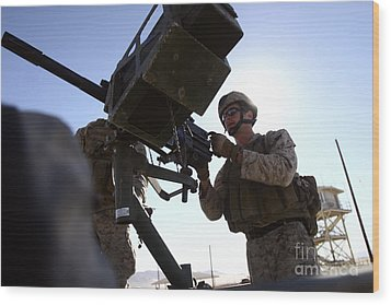 A Soldier Fires 40mm Rounds Wood Print by Stocktrek Images