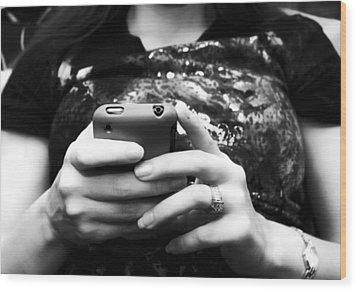 A Woman And Her Phone Wood Print by Ricky Barnard