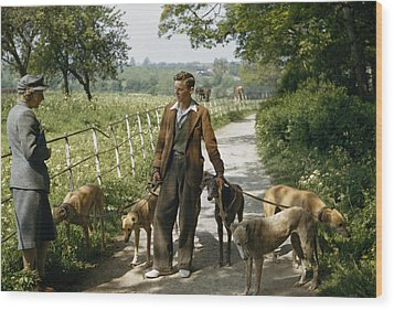 A Woman Talks With A Man Walking Racing Wood Print by B. Anthony Stewart