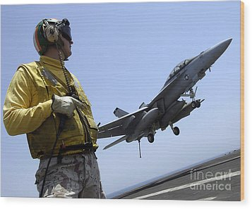 An Officer Observes An Fa-18f Super Wood Print by Stocktrek Images