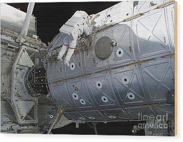 Astronaut Traverses Along The Destiny Wood Print by Stocktrek Images
