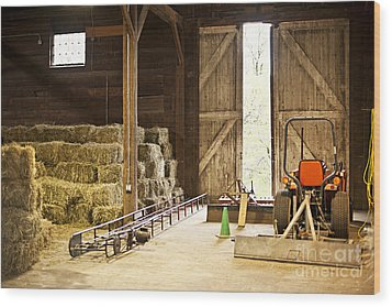 Barn With Hay Bales And Farm Equipment Wood Print by Elena Elisseeva