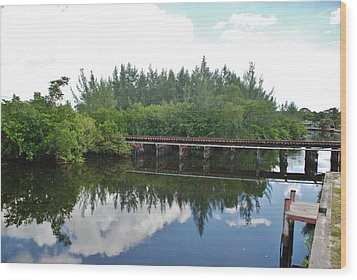 Big Sky And Docks On The River Wood Print by Rob Hans