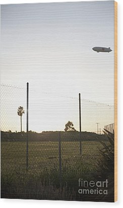 Blimp Flying Over Sports Field Wood Print by Sam Bloomberg-rissman