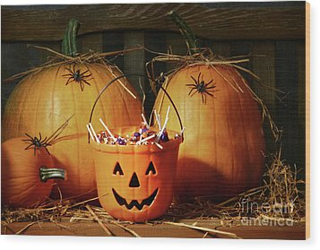 Bucket Filled With Halloween Candy Wood Print by Sandra Cunningham