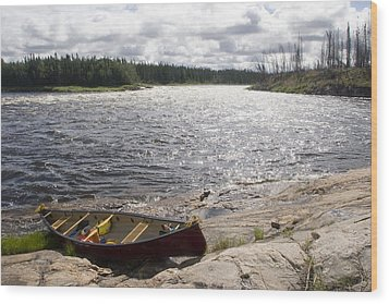 Canoe Pulled Up On The Shore Wood Print by Skip Brown