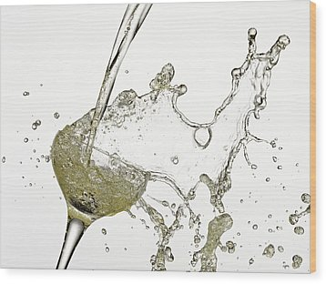 Champagne Being Poured Into Glass Wood Print by Andy Roberts