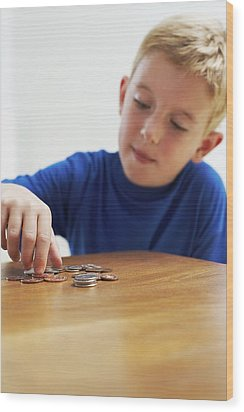 Child With Loose Change Wood Print by Ian Boddy